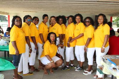 group of women on yellow shirt